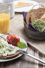 healthy spring summer low fat breakfast with orange juice,coffee,bread,cottage cheese, cress and tomatos