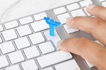 Woman pressing fitness button on computer keyboard