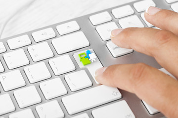 Woman pressing new job button on computer keyboard