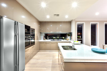Modern kitchen with refrigerator and fixed to the wall with cabi