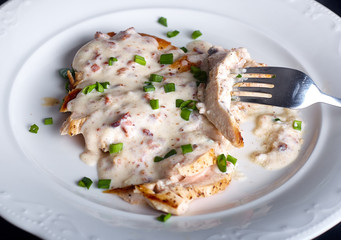 Grilled chicken breast with cheese sauce