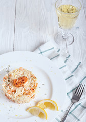 Risotto with shrimp and glass of white wine