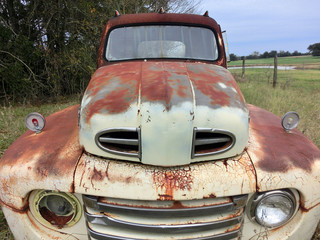 Old rusty abandoned truck front shot - landscape color photo