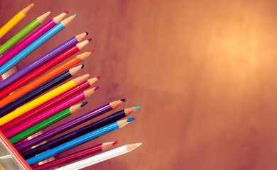 Group of colourful pencil crayons in a row