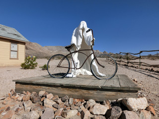 Ghost bike rider in the desert sun - landscape color photo