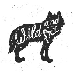 "Silhouette of a wolf. Hand drawn typography poster, greeting card, for t-shirt design ""Wild and free"",  hand lettering quote. Vector illustration"