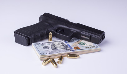 Black gun with american dollars