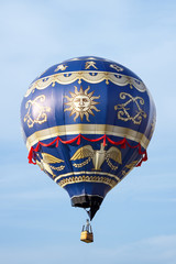 hot air balloon moving up in blue sky.