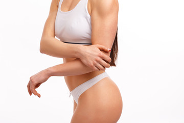 Sporty woman having pain in hers elbow