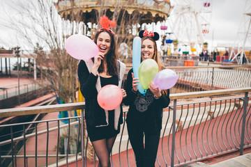 Two girls having fun at an amusement park