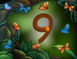 Number nine with 9 butterflies in the garden