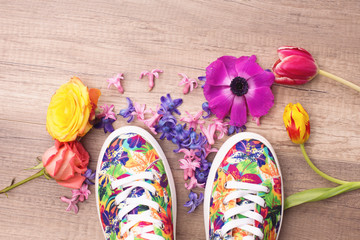 Sneakers and flowers around