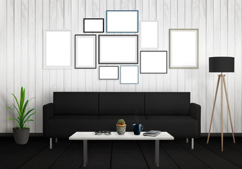 Isolated group of wall art frames. Sofa, lamp, plant and table in room interior.