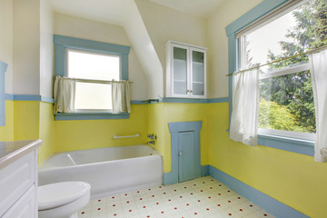 Cute bathroom with yellow walls