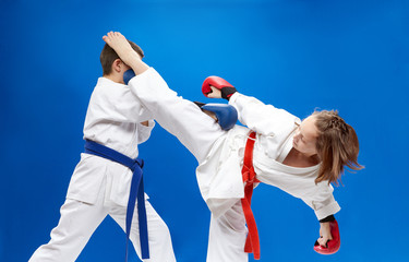 With overlays on the hands of the athletes are training blows karate