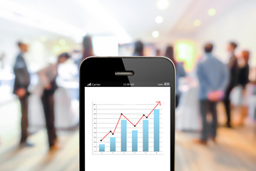 close up mobile phone with analyzing graph,planing,business succ