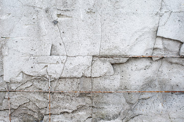 Texture cement wall of destroyed construction with fittings