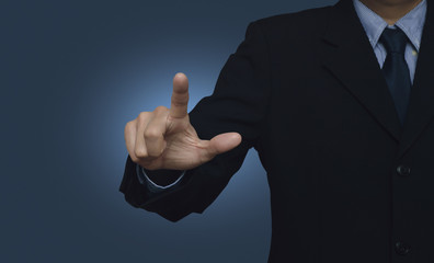 Businessman pointing to something or touching a touch screen on
