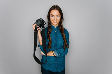 Portrait of cute teen girl making pictures to herself isolated on gray and studio background posing to the camera