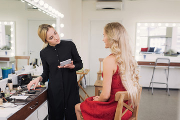 stylist assesses how to do make-up