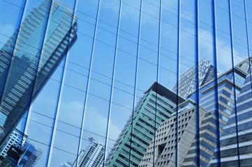 Fototapete - Reflect of modern city tower on metal wall, Bangkok Thailand