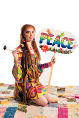 Young pretty hippie girl with peace poster and bong