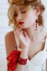 Beautiful blond bride with provocative red lips