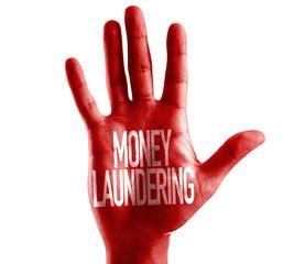 Money Laundering written on hand isolated on white background