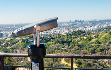 coin operated binoculars against Los Angeles' skyline