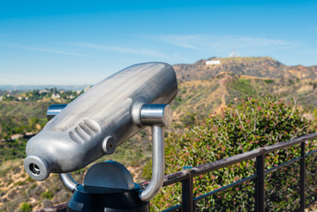 coin operated binoculars aiming at Hollywood hills.