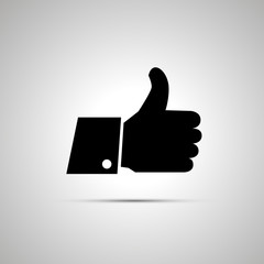 Black thumbs up icon with shadow
