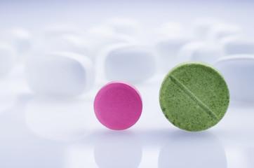 Medicine pink and green pill. Close-up
