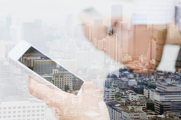 Double exposure image of people with smart phone and cityscape background,communication technology concept.