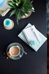 Planning summer vacation trip with cup of coffee and notebooks