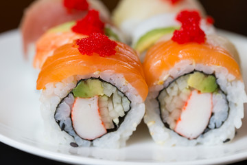 Recess Fitting Sushi bar Sushi set, sushi roll with salmon and sushi roll with avocado.