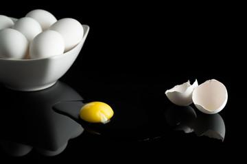 Broken egg in a black background