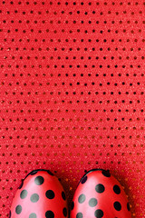 red shoes patterned with black dots