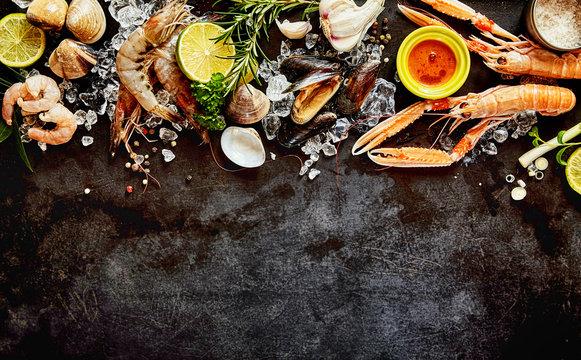 Fresh Seafood and Ingredients on Dark Background