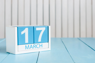 Happy St Patricks Day save the date. March 17th. Image of march 17 wooden color calendar on white background.  Spring day, empty space for text