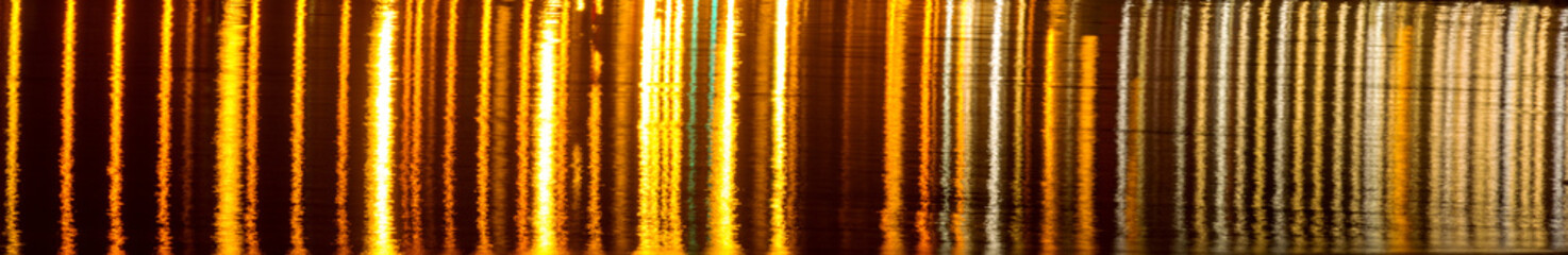 Reflected in another source of light - Sodium Light Chromatography reflected on the River Mersey