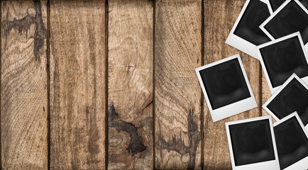 Polaroid photo frames wooden background. Wood table texture