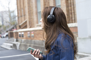 Young woman wearing headphones