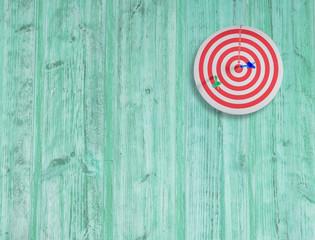 dart target on color wood wall