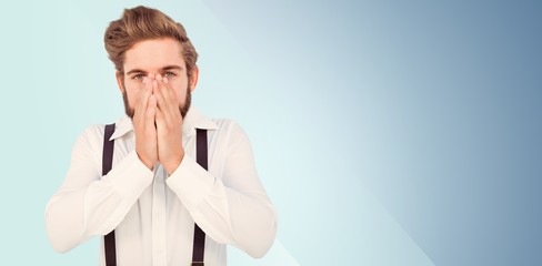Composite image of portrait of hipster with hands covering mouth