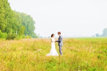 Young wedding couple walking outdoors