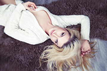 portrait of a beautiful sexy blonde woman lying on the floor