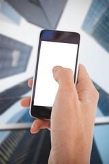 Composite image of cropped hand of man using mobile phone