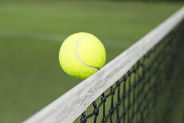 Tennis ball touching net