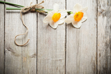 two flowers on wooden background