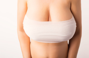 Woman after breasts enlargement surgery